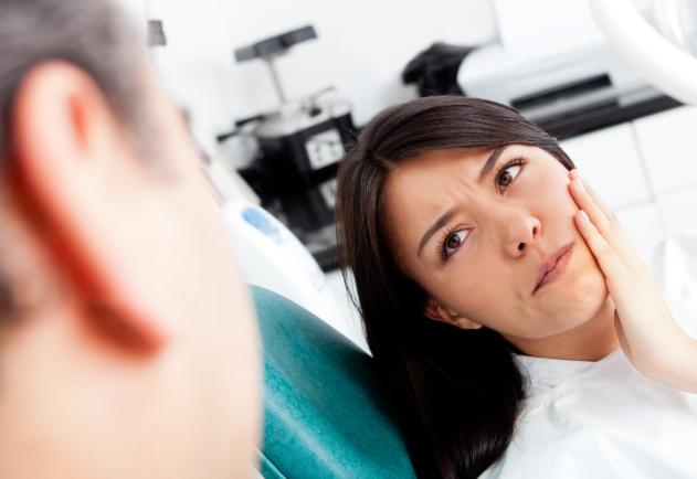 woman concerned sitting in a dental chair