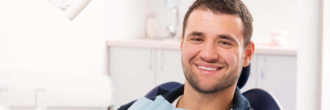 man smiling in dentist chair | Carrollwood, FL 33618